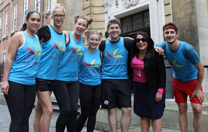 A group of staff from the Grand Hotel York in their running gear, ready to run for IDAS in the 10K