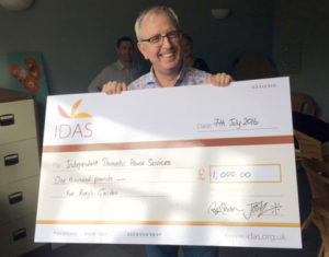 Rory holding his donation for IDAS