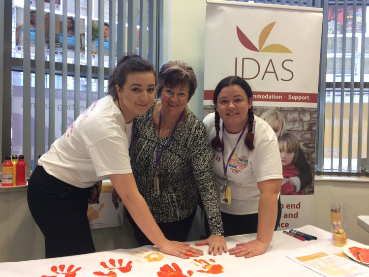 IDAS workers make their hand print posters