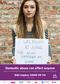 Girl holding a sign which reads - I was bullied at school for what happened at home