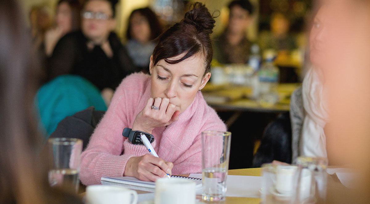 Woman making notes during a training session