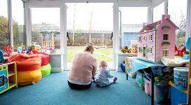 Woman and her baby in a refuge playroom