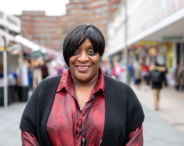 Woman smiling standing in Sheffield market